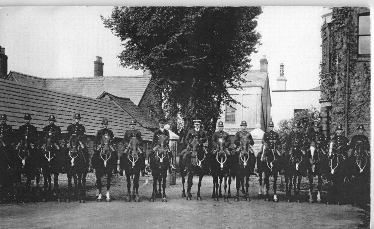 Gloucestershire Constabulary mounted police at Miners' Strike - Forest of Dean in 1926. Photograph taken at Feathers Hotel Lydney. Police Constable Harry Watkins on the right. Police Constable John Meadows seventh from the right Police Constable Morton Fluck second from right