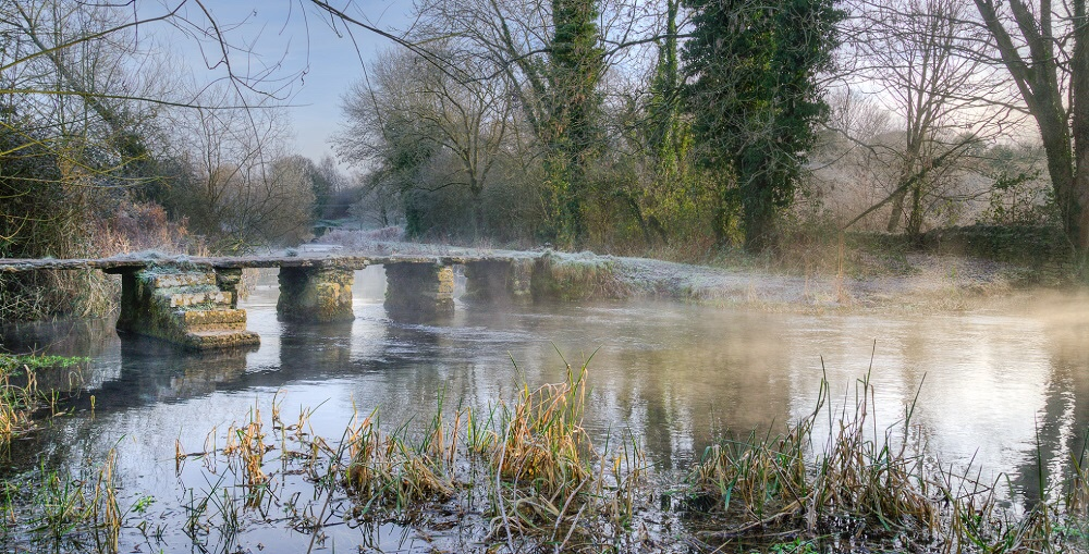 The Keble Bridge over the River Leach at Eastlach, Cirencester, Gloucestershire in the Cotswolds