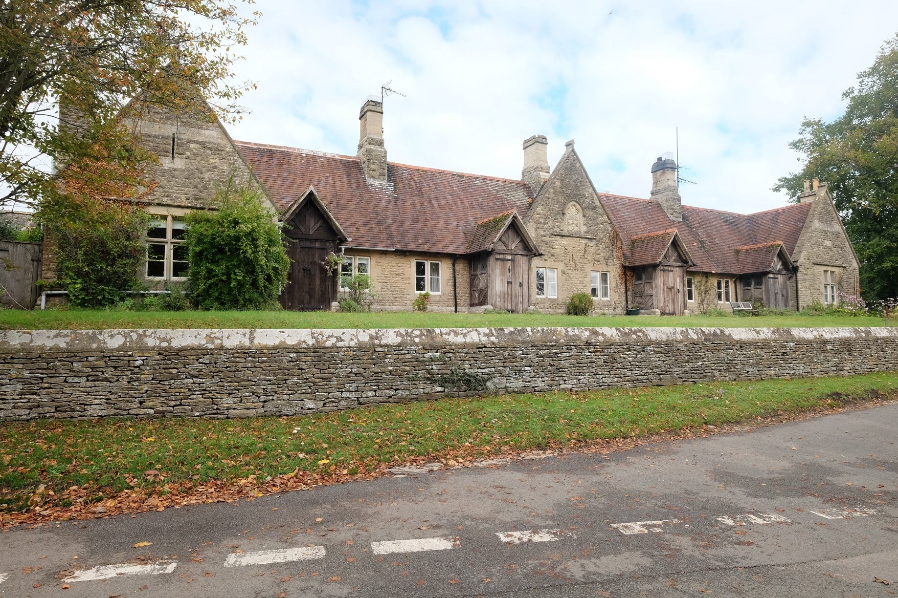 The former Alms houses is now a row of three cottages with a prominent place at the top of the village.