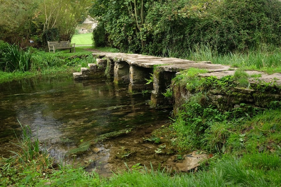 """The ancient clapper bridge over the River Leach in Eastleach, is known locally as the """"Keble's Bridge"""" named after John Keble who was curate to the church of St. Michael & St. Martin in the village."""