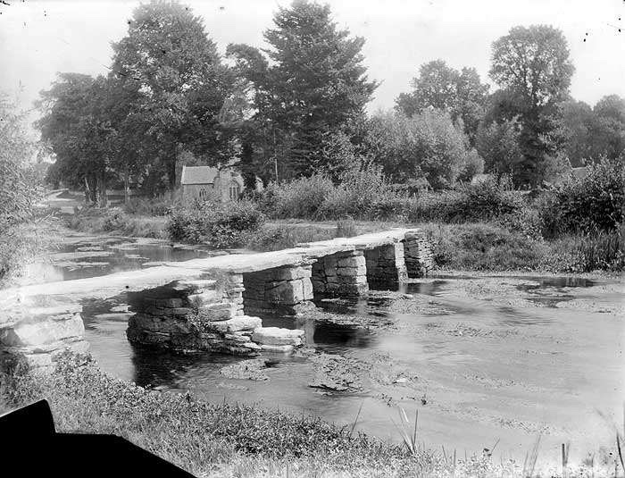 """The ancient clapper bridge over the River Leach is known locally as the """"Keble's Bridge"""" named after John Keble who was curate to the church of St. Michael & St. Martin in the village."""